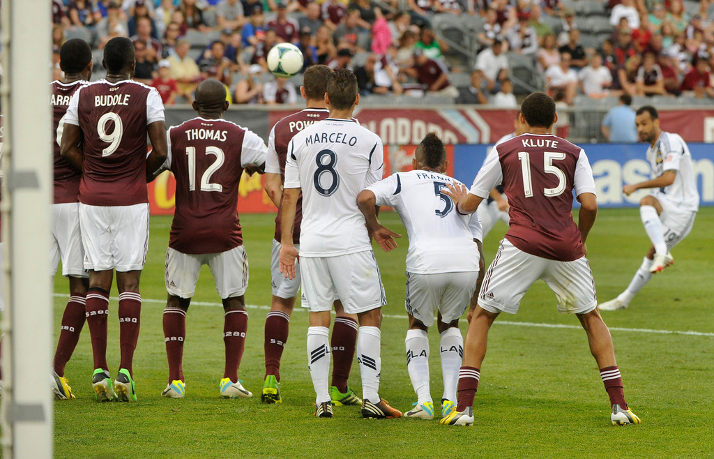 . COMMERCE CITY, CO. - JULY 27:  Galaxy midfielder Juninho tried to lift a shot over the Rapids wall late in the second half. The Colorado Rapids defeated the Los Angeles Galaxy 2-0 Saturday, July 27, 2013.  Photo By Karl Gehring/The Denver Post