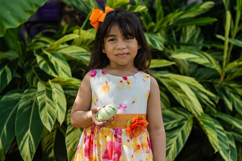 Bella Carmona of West Palm Beach holds her favorite pumpkin at the The Royal Poinciana Plaza's Pop-Up Patch for Philanthropy benefitting Cancer Alliance of Help and Hope, Saturday, October 10, 2020. 100 percent of the funds raised from the pumpkin patch will be used to help local cancer patients with their rent/mortgage, utilities, car insurance, car payment and health insurance while undergoing treatment. It's estimated that there will be about 5,000 pumpkins over the duration of the event.(JOSEPH FORZANO / THE PALM BEACH DAILY NEWS)