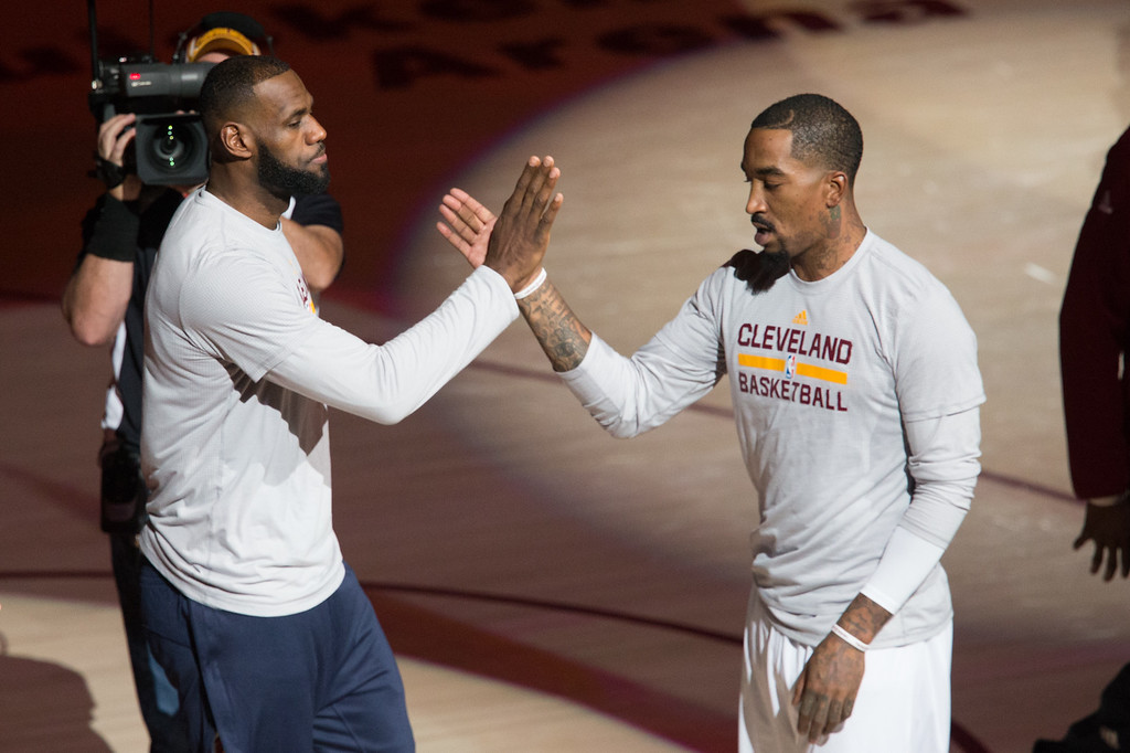 . Michael Johnson - The News-Herald Lebron James (left) and JR Smith (right) of the Cleveland Cavaliers greet each other before a home game against the Portland Trailblazers on November 23, 2016 at the Quicken Loans Arena.