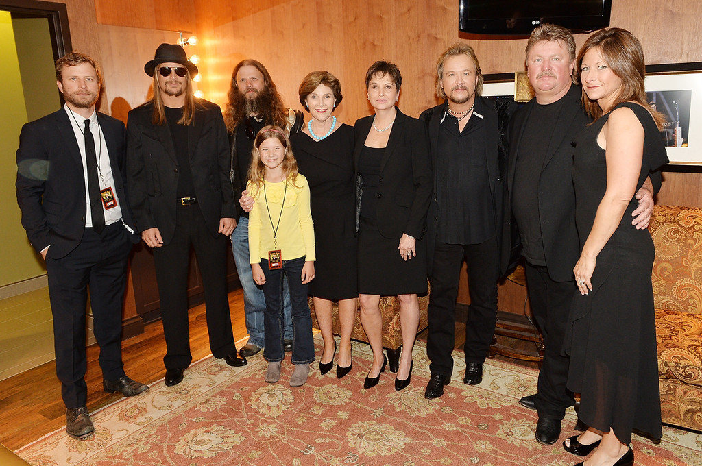 . (L-R) Dierks Bentley, Kid Rock, Jamey Johnson, Kaylee Johnson, Laura Bush, Nancy Jones, Travis Tritt, Joe Diffie, and Theresa Crump attend the funeral service for George Jones at The Grand Ole Opry on May 2, 2013 in Nashville, Tennessee. (Photo by Rick Diamond/Getty Images for GJ Memorial)