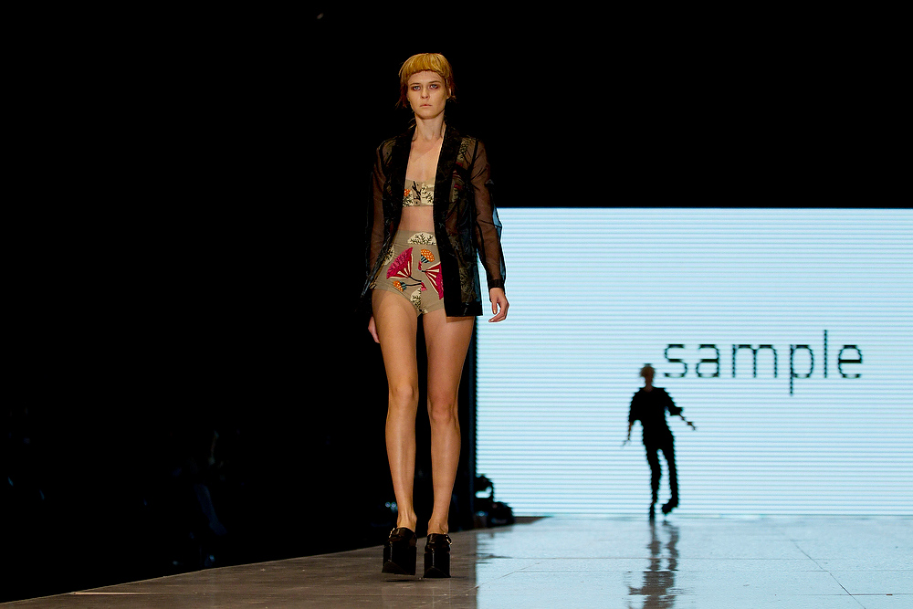 . A model wears a creation by the Israeli designers Sample during a show at the Tel Aviv fashion week in Israel, Monday, Dec. 17, 2012. (AP Photo/Ariel Schalit)