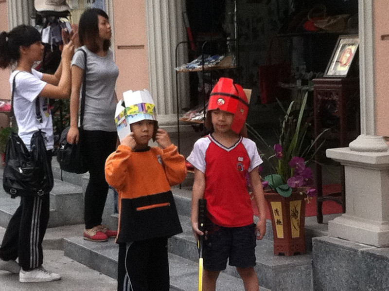 I couldn't resist but stupid backstory on this one.  I worked for a while with research pesticides and we joked that if you worked with them too long you'd end up having kids with square heads who could wear boxes for hats.  Then...in China...two boys appear playing with swords...and wearing boxes for hats!!!