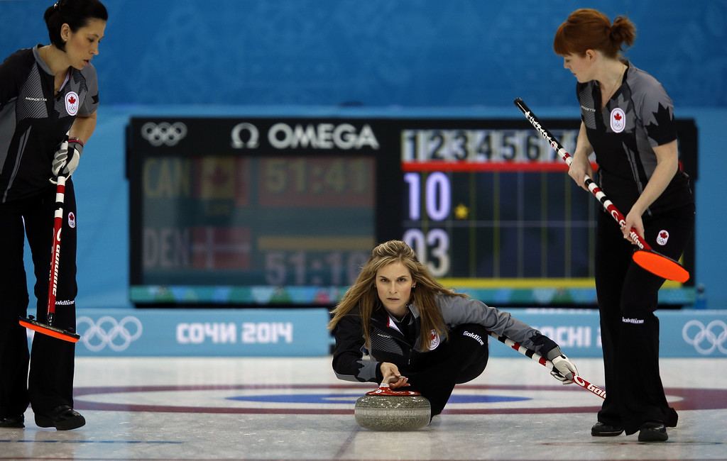 . Canada\'s Jennifer Jones throws her stone during the women\'s curling round robin session 5 match between Canada and Denmark at the Ice Cube curling centre in Sochi on February 13, 2014 during the 2014 Sochi winter Olympics. ADRIAN DENNIS/AFP/Getty Images