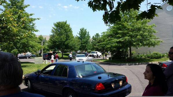 . Police let some residents back onto Harvard Drive in Montgomery Township after a shooting Monday, June 2, 2014. (Photo by Dan Sokil)