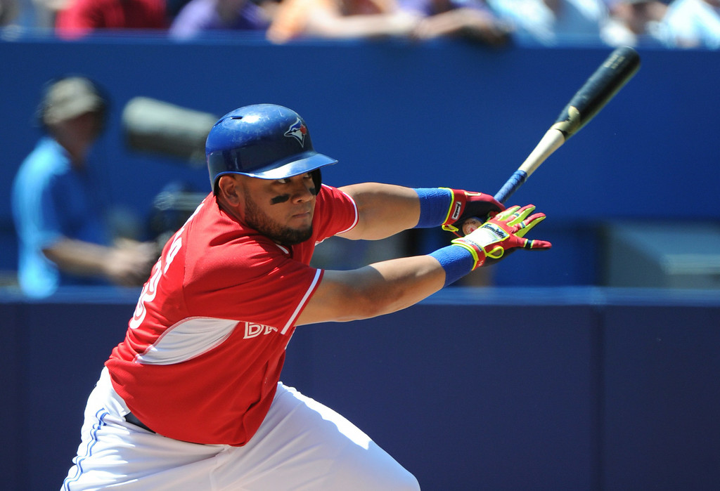 . Toronto Blue Jays\' Melky Cabrera singles against the Detroit Tigers during the first inning of a baseball game on Sunday, Aug. 10, 2014, in Toronto.  (AP Photo/The Canadian Press, Jon Blacker)