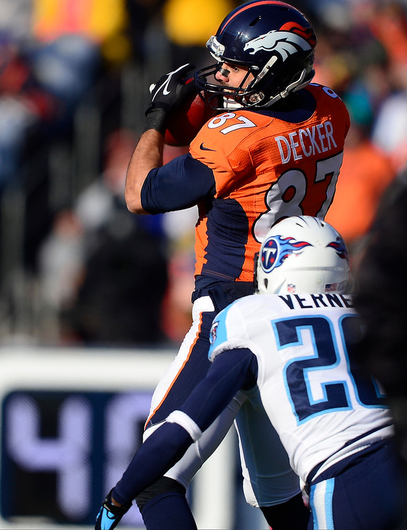 . Denver Broncos wide receiver Eric Decker (87) makes a catch in the first quarter for a first down.   (Photo by AAron Ontiveroz/The Denver Post)