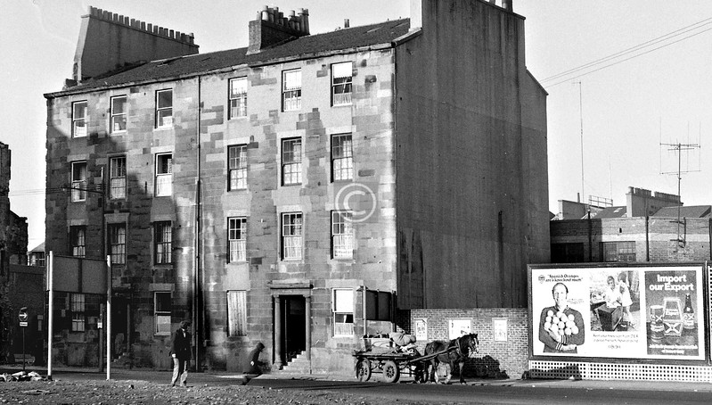Oxford St, north side between Bridge St and S. Portland St.   This tenement, 154 - 162,  the closemouths enhanced by Doric columns, was probably the oldest tenement still standing in the Gorbals. Dating from around 1815, it preceded the still grander Abbotsford Place by 10-20 years.   November 1973