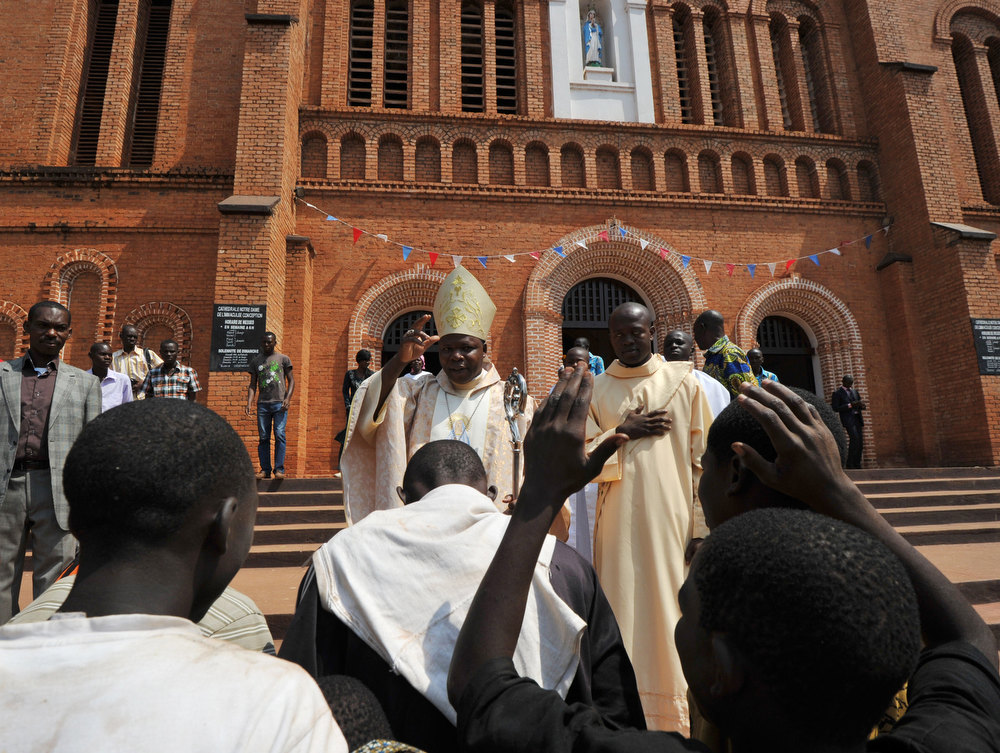 . Nzapalainga Dieudonne, bishop of Bangui (C), prays in front of the cathedral in Bangui, on January 1, 2013. The death of a young Muslim man arrested for alleged links to rebels in the Central African Republic sparked clashes on January 1, 2013 in the capital that killed a policeman, a police source said. The unrest erupted as countries in the region sent reinforcements to protect the capital Bangui from rebels who control much of the country and are demanding the departure of President Francois Bozize. SIA KAMBOU/AFP/Getty Images
