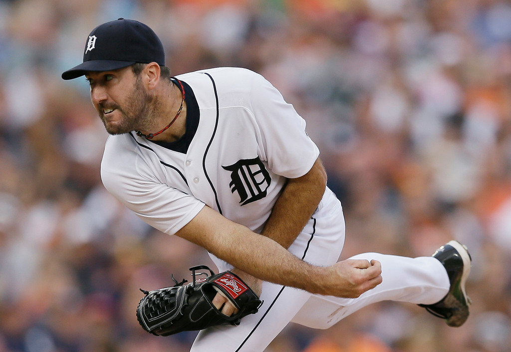 . Detroit Tigers starting pitcher Justin Verlander follows through during the fourth inning of an interleague baseball game against the Colorado Rockies, Friday, Aug. 1, 2014, in Detroit. (AP Photo/Carlos Osorio)