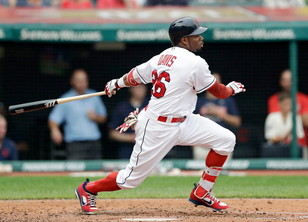 . Cleveland Indians\' Rajai Davis watches his ball after hitting an RBI-single off Chicago White Sox starting pitcher Reynaldo Lopez in the fourth inning of a baseball game, Wednesday, June 20, 2018, in Cleveland. Yan Gomes scored on the play. (AP Photo/Tony Dejak)