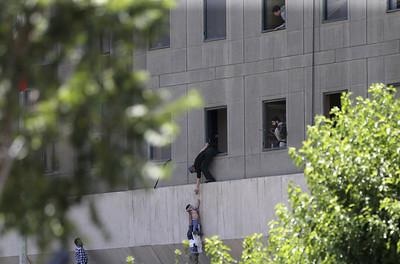 isclaimed-attacks-on-irans-parliament-shrine-kill-12