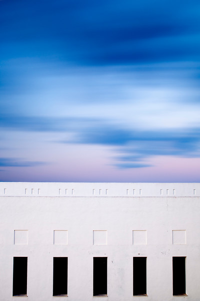 Moving clouds over a building. Long exposure shot.