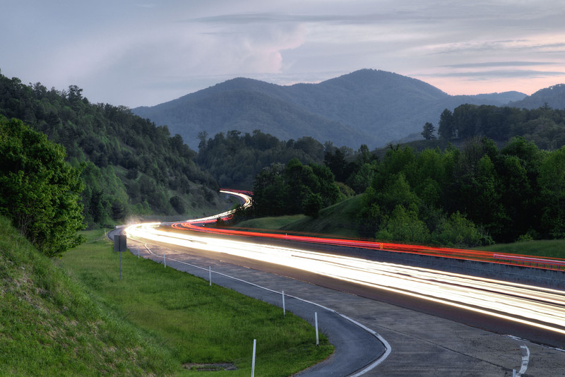 Light trails from passing vehicles on Interstate 26 during dusk at a Scenic Overlook near Erwin, TN on Sunday, May 10, 2015. Copyright 2015 Jason Barnette