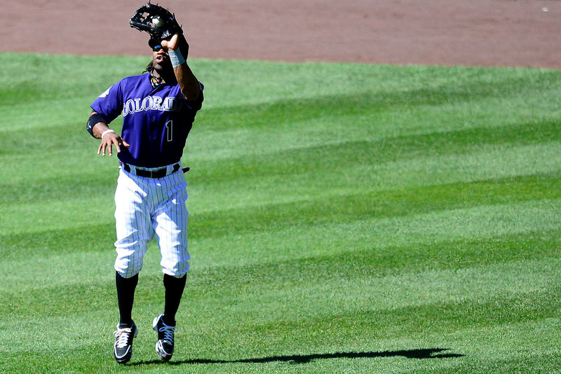 . Colorado Rockies right fielder Eric Young Jr. (1) makes a catch on a ball hit by San Diego Padres second baseman Jedd Gyorko (9) during the action in Denver. The Colorado Rockies hosted the San Diego Padres at Coors Field on Sunday, June 9, 2013. (Photo by AAron Ontiveroz/The Denver Post)