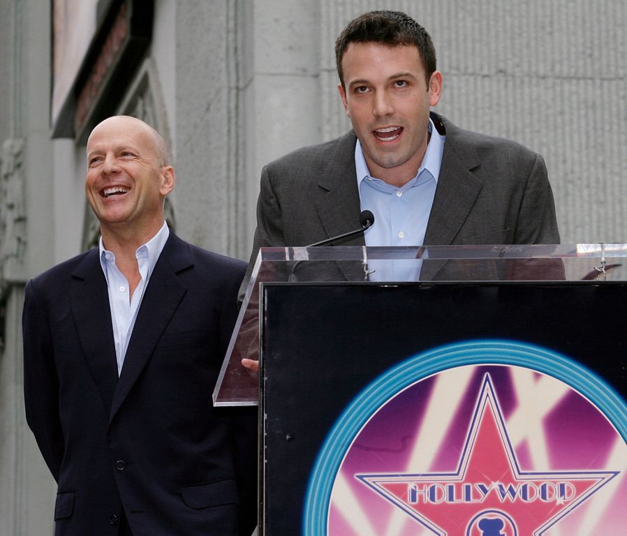 . Actor Ben Affleck, right, speaks during a ceremony honoring Bruce Willis, left, with a star on the Hollywood Walk of Fame in the Hollywood section of Los Angeles, Monday, Oct. 16, 2006. (AP Photo/Damian Dovarganes)