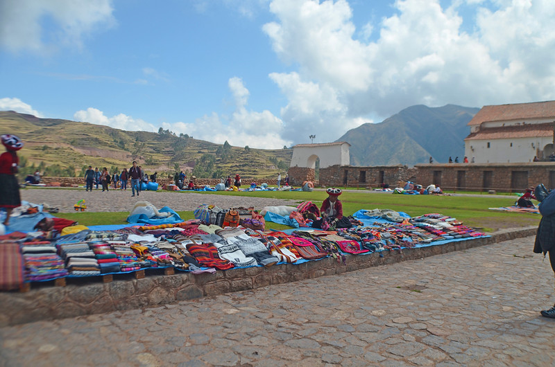 a display of colorful textiles in chinchero