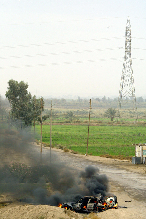 . An abandoned car burns on the side of the road leading to the northwest of Fallujah, shot by a US military Bradley 08 November 2004, 50 kms west of Baghdad. AFP PHOTO/PATRICK BAZ  AFP/Getty Images