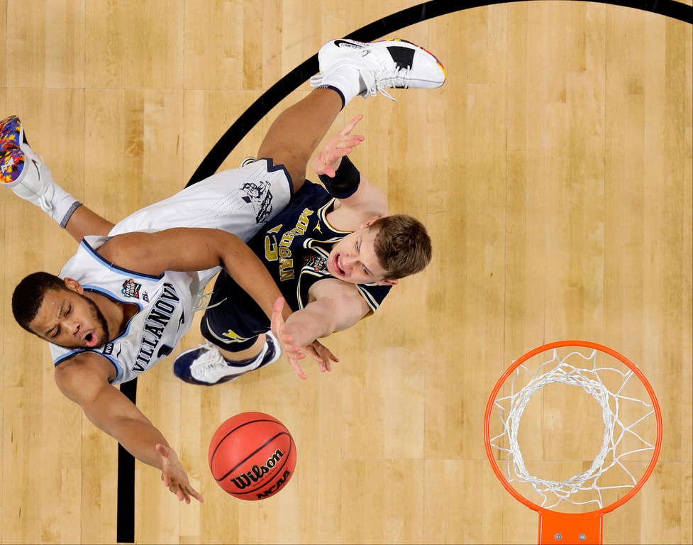 . Villanova forward Omari Spellman, left, drives to the basket over Michigan forward Moritz Wagner during the first half in the championship game of the Final Four NCAA college basketball tournament, Monday, April 2, 2018, in San Antonio. (AP Photo/Eric Gay)
