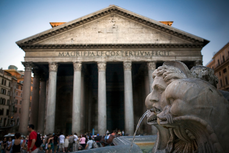 Frontal view of the Pantheon from the Rotonda square fountain, Rome