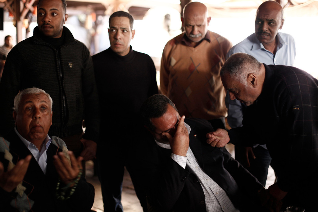 . Residents of Port Said react to the announcement of the final verdict in the case of the Port Said football massacre, on March 9, 2013, in Port Said, Egypt.(Photo by Ed Giles/Getty Images).