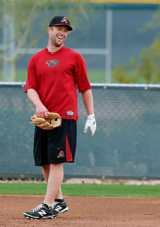 . Arizona Diamondbacks\' Aaron Hill laughs with his teammates during an informal practice a day prior to the start of baseball spring training for pitchers and catchers, at the Diamondbacks\' training facility Thursday, Feb. 6, 2014, in Scottsdale, Ariz. (AP Photo/Ross D. Franklin)