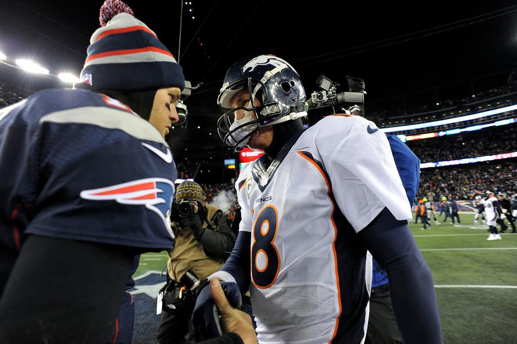 . Denver Broncos quarterback Peyton Manning (18) shakes hands with New England Patriots quarterback Tom Brady (12) after the overtime game November 24, 2013 at Gillette Stadium. (Photo by John Leyba/The Denver Post)