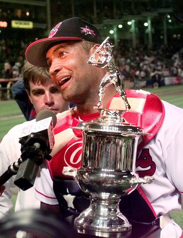 . The Cleveland Indians\' Sandy Alomar holds the MVP trophy after the All-Star Game Tuesday July 8, 1997, in Cleveland.  The American League beat the National League 3-1 after Alomar\'s two-run homer in the seventh inning.  (AP Photo/Mark Duncan)