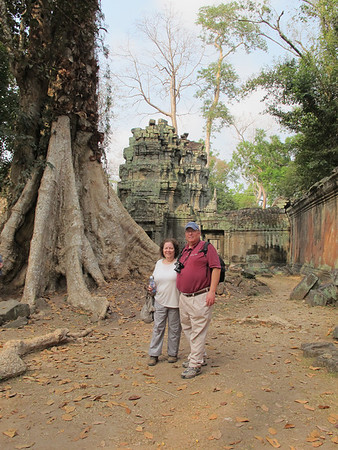 Renee and Ellis Mirsky at Ta Prohm.  Re-discovered in 19th century, trees have swallowed the temple. it has been left as found.  http://www.angkorwhat.net/news/angkor-wat-temples.html
