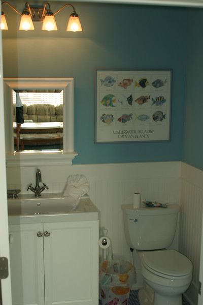 1st floor pool bath w/ shower- access from pool deck & playroom