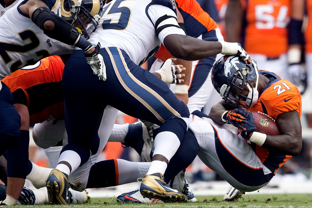 . DENVER, CO - AUGUST 24: Ronnie Hillman (21) of the Denver Broncos gets tackled by the St. Louis Rams defense during the first half of action of an NFL preseason game at Sports Authority Field at Mile High on August 24, 2013. This is the third game of the preseason for the Broncos. (Photo by AAron Ontiveroz/The Denver Post)