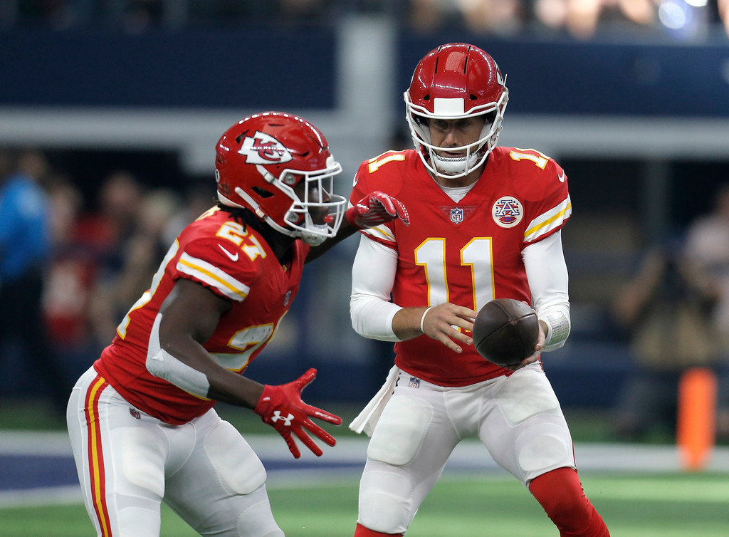 . Kansas City Chiefs\' Kareem Hunt (27) takes the hand off from quarterback Alex Smith (11) in the first half of an NFL football game against the Dallas Cowboys on Sunday, Nov. 5, 2017, in Arlington, Texas. (AP Photo/Brandon Wade)