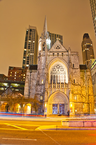 Chicago's Fourth Presbyterian Church at night with motion blurs from traffic.