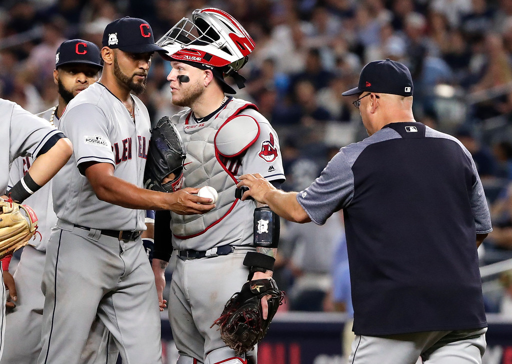 . Cleveland Indians pitcher Danny Salazar hands the ball to manager Terry Francona as he leaves the game during the fifth inning in Game 4 of baseball\'s American League Division Series against the New York Yankees, Monday, Oct. 9, 2017, in New York. (AP Photo/Frank Franklin II)