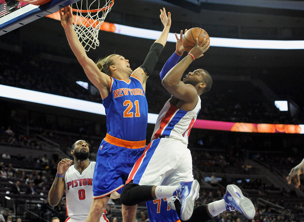 . Detroit Pistons forward Greg Monroe (10) goes up for a shot as he is guarded by New York Knicks forward Lou Amundson in the first quarter, Friday, Feb. 27, 2015 at The Palace in Auburn Hills, Mich.  (Special to The Oakland Press/Jose Juarez)
