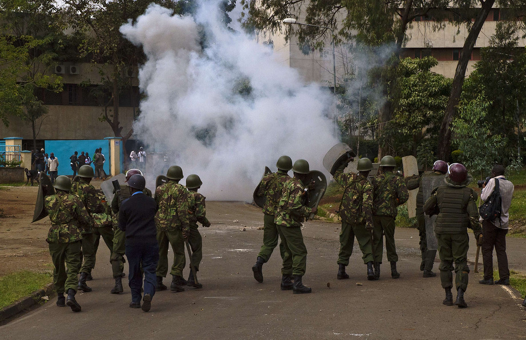 . Kenyan riot police fire tear gas at students outside Nairobi University on May 20, 2014. The students were protesting against a controversial fee increment which ended in a riot with tear gas fired and riot police forcing their way inside the university to arrest students after rocks were thrown. CARL DE SOUZA/AFP/Getty Images