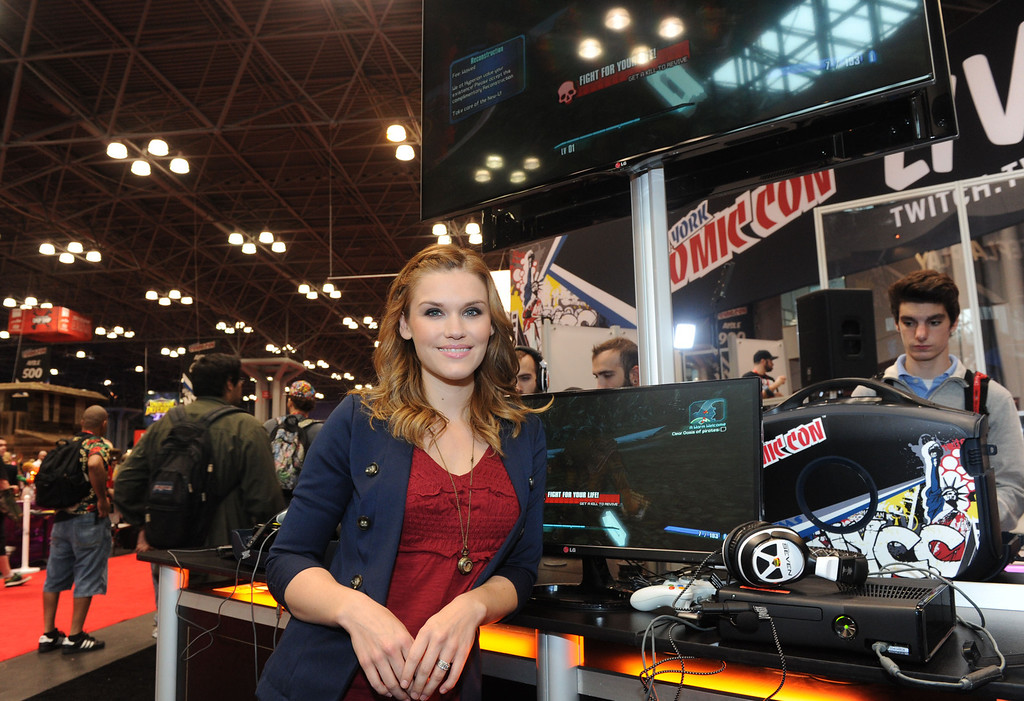 . Emily Rose, star of the TV series Haven, stops by the Video Game Free Play Zone at New York Comic Con on Friday, Oct. 11, 2013.  (Photo by Diane Bondareff/Invision for LG/AP Images)