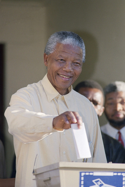 . ANC leader Nelson Mandela casts his vote at Ohlanga High School hall in Inanda. 10 miles (15 km) north of  Durban on Wednesday, April 27, 1994, for South Africa\'s first all-race elections. Mandela is strongly favored to become South Africa\'s first black President after results are announced later that week. (AP Photo/Peter Dejong)
