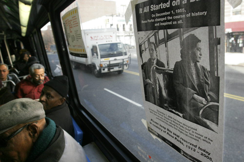 ". A poster entitled ""It All Started On A Bus,\"" is posted above the front seat of a New York City bus to honor Rosa Parks in Harlem, New York, Dec. 1, 2005. Today marks the 50th anniversary of act of civil disobedience by Rosa Parks, an African American woman who was jailed after she refused to give up her seat to a white passenger on a segregated bus in Montgomery, Alabama. Her action fueled the civil rights movement and the MTA hope transit riders will leave the reserved seat empty as a tribute to Parks. (AP Photo/Bebeto Matthews)"