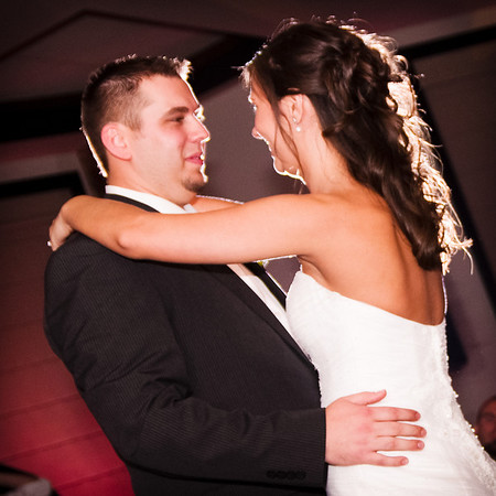 Beautiful bride and groom share their first dance at Franchesco's during their wedding reception, Rockford IL.