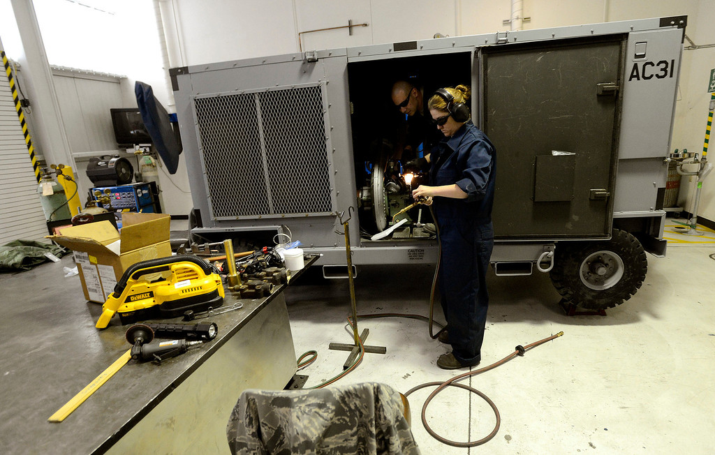 . Staff Sergeant Melody Witt works on an aircraft air conditioning unit at March Air Reserve Base in Riverside March 6, 2013.  The base is one of many that will be affected by the Federal sequestration.  GABRIEL LUIS ACOSTA/STAFF PHOTOGRAPHER.