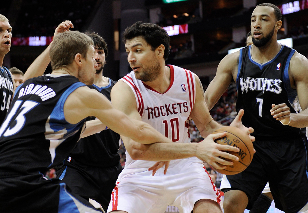 . Houston Rockets\' Carlos Delfino (10) is surrounded by Minnesota Timberwolves players in the second half. (AP Photo/Pat Sullivan)