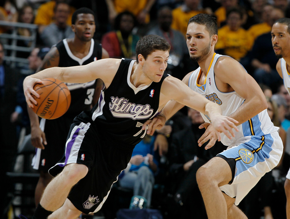 . Sacramento Kings guard Jimmer Fredette, left, works the ball inside past Denver Nuggets guard Evan Fournier, of France, in the fourth quarter of the Nuggets\' 121-93 victory in an NBA basketball game in Denver on Saturday, Jan. 26, 2013. (AP Photo/David Zalubowski)
