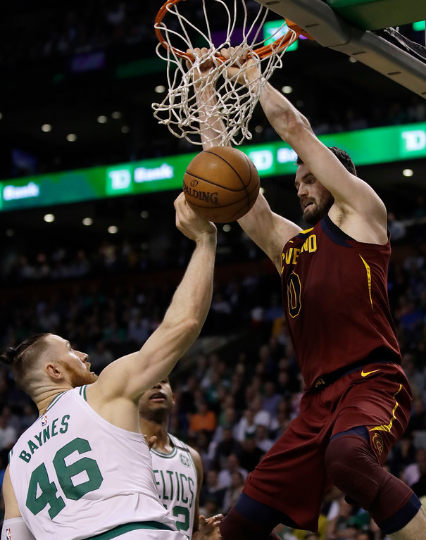 . Cleveland Cavaliers center Kevin Love, right, dunks over Boston Celtics center Aron Baynes during the first half in Game 2 of the NBA basketball Eastern Conference finals Tuesday, May 15, 2018, in Boston. (AP Photo/Charles Krupa)