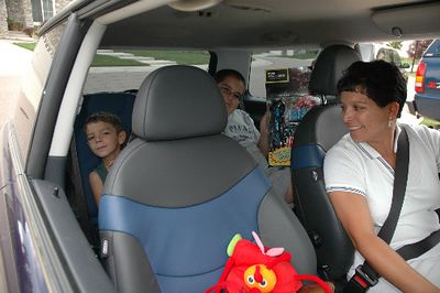A couple of cousins, Evan and Chance, riding in the backseat, after a full day (Saturday) at the Invitational.