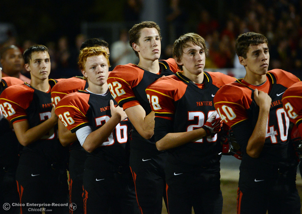 . Chico High\'s #33 Austin Ruble, #36 Justin Ledyard, #32 Ryan Calbert, #28 Jordan Teja, and #40 Jacob Manuel (left to right) stand for the National Anthem against Central Valley High in the first quarter of their football game at Asgard Yard Friday, September 27, 2013, in Chico, Calif.  (Jason Halley/Chico Enterprise-Record)