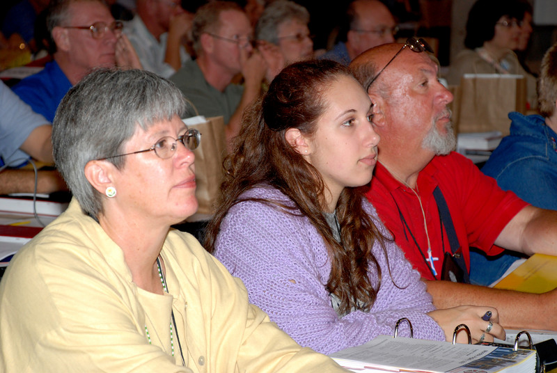 Voting Members listening to Secretary Lowell Almen of the ELCA.