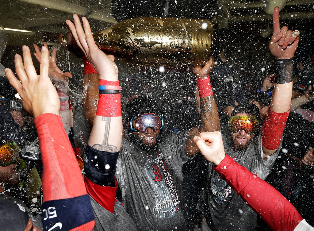 . Boston Red Sox\'s David Ortiz celebrates with teammates after Game 6 of baseball\'s World Series against the St. Louis Cardinals Thursday, Oct. 31, 2013, in Boston. The Red Sox won 6-1 to win the series. Ortiz was names the series MVP. (AP Photo/David J. Phillip)