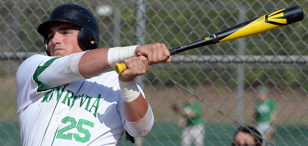 . Monrovia\'s Jason Daly watches his RBI single as Nick Carino (not pictured) scores against Alhambra in the first inning of the Arcadia Elk Baseball Tournament at Monrovia High School in Monrovia, Calif., on Thursday, March 13, 2014. Monrovia won 2-0.  (Keith Birmingham Pasadena Star-News)