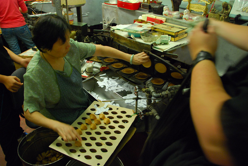 """We visited a fortune cookie """"factory"""" in Chinatown.  It wasn't so much a factory as it was an old lady."""