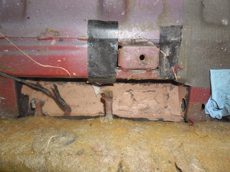 Previous repair to seatbelt mount